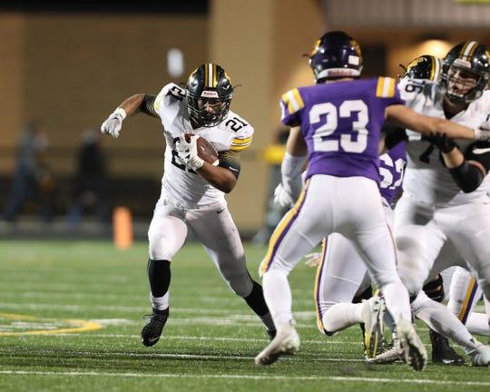 Nov 2, 2018; Johnston, IA, USA; Southeast Polk Rams Gavin Williams (21) runs the football against the Johnston Dragons at Johnston Stadium. The Rams beat the Dragons 21-7.