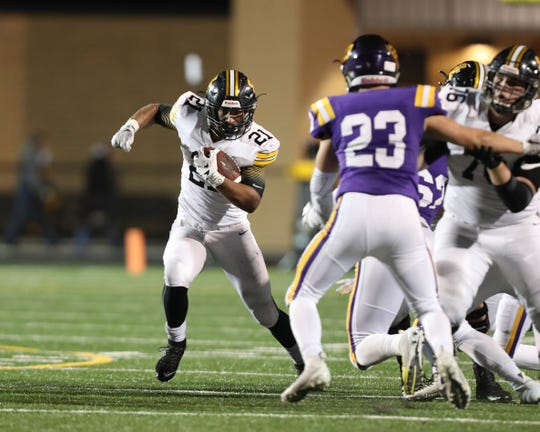 Nov 2, 2018; Johnston, IA, USA; Southeast Polk Rams Gavin Williams (21) runs the football against the Johnston Dragons at Johnston Stadium. The Rams beat the Dragons 21-7.