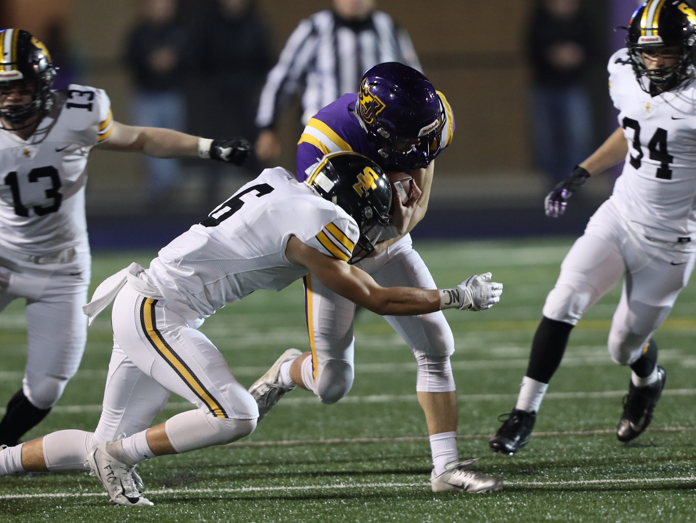 Nov 2, 2018; Johnston, IA, USA; Southeast Polk Rams Dylan Travis (6) makes the tackle against the Johnston Dragons at Johnston Stadium. The Rams beat the Dragons 21-7.