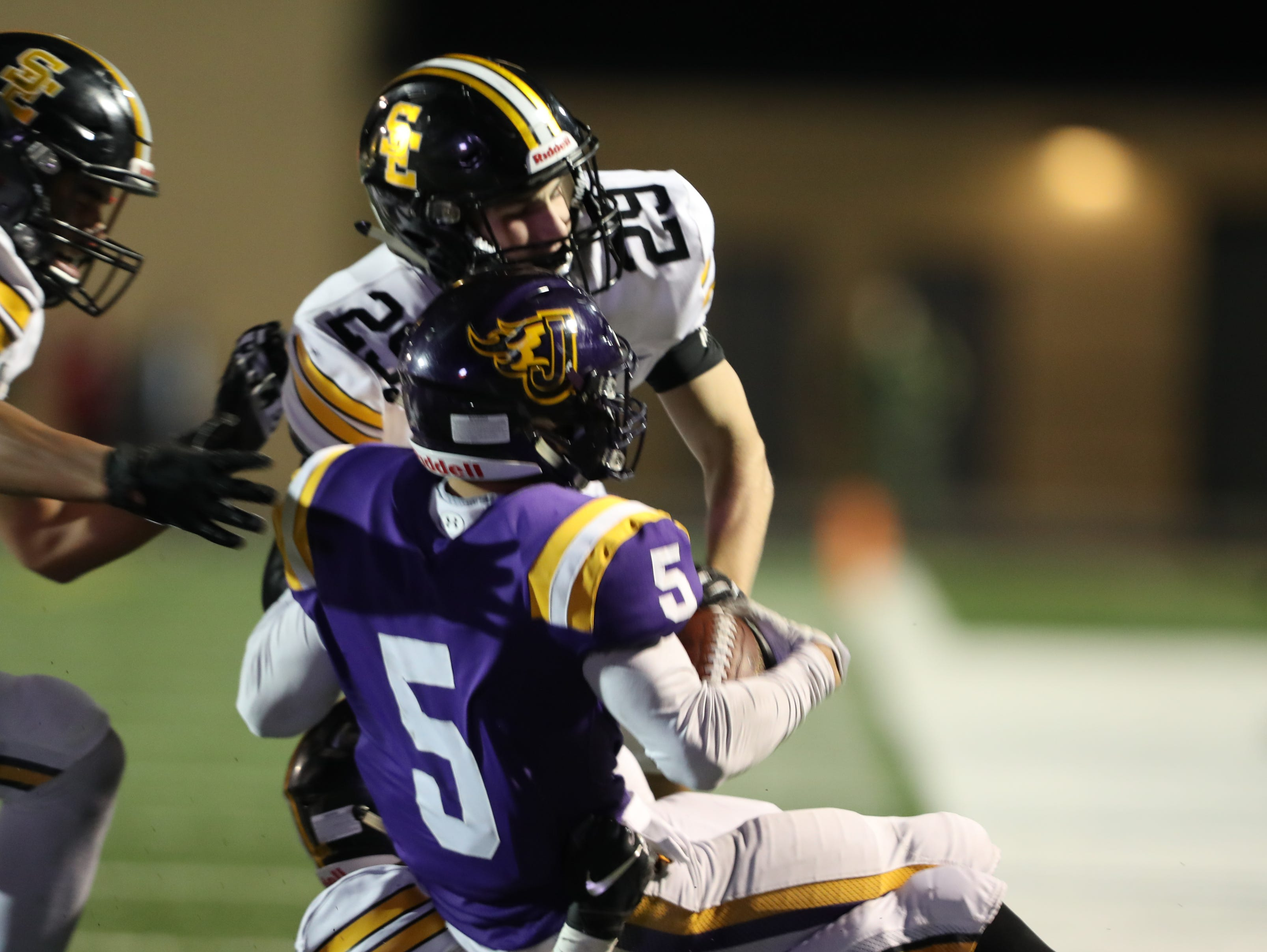 Nov 2, 2018; Johnston, IA, USA; Southeast Polk Rams Daniel Hackbarth (29) tackles Johnston Dragons Anthony Coleman (5) at Johnston Stadium. The Rams beat the Dragons 21-7.