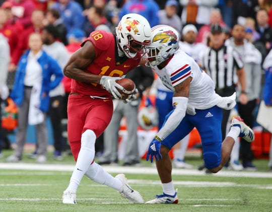 Nov 3, 2018; Lawrence, KS, USA; Iowa State Cyclones wide receiver Hakeem Butler (18) catches a pass for a touchdown as Kansas Jayhawks wide receiver Evan Fairs (3) defends in the first half at Memorial Stadium.