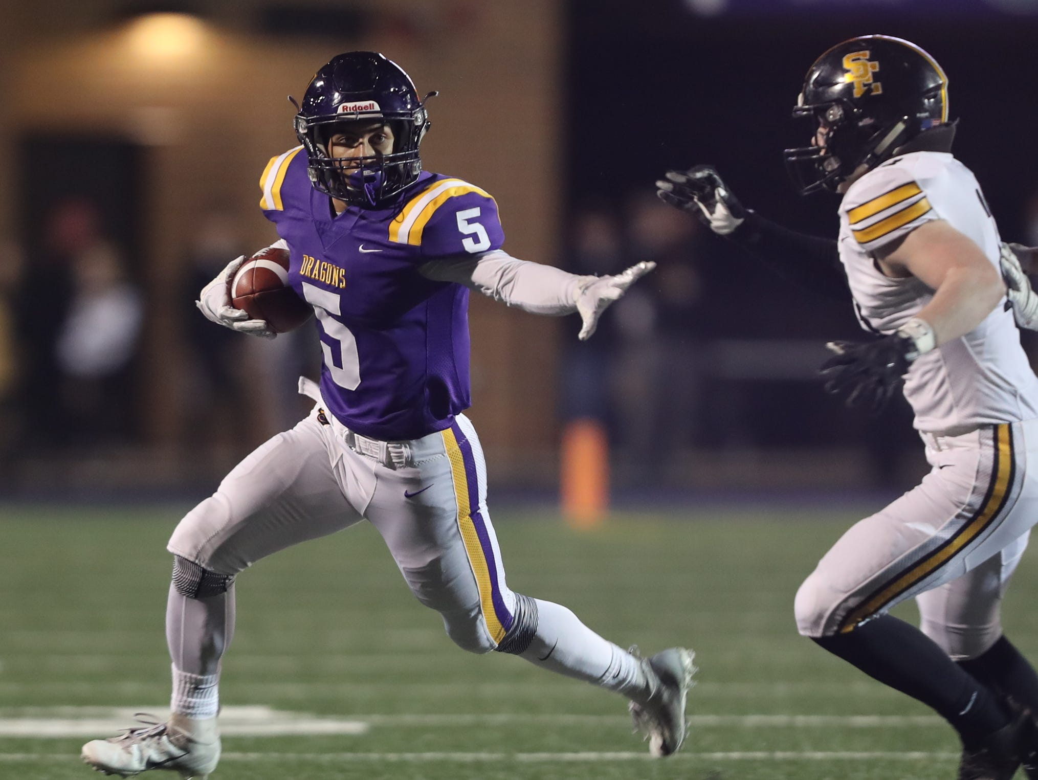 Nov 2, 2018; Johnston, IA, USA; Johnston Dragons Anthony Coleman (5) runs the football against the Southeast Polk Rams at Johnston Stadium. The Rams beat the Dragons 21-7.