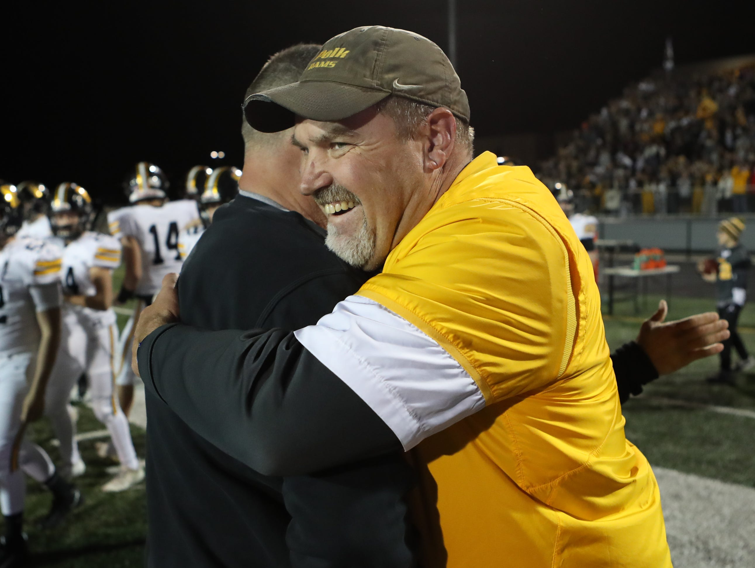 Nov 2, 2018; Johnston, IA, USA; Southeast Polk Rams head coach Brad Zelenovich and Defensive Coordinator Don Starcevich embrace after their win against the Johnston Dragons at Johnston Stadium. The Rams beat the Dragons 21-7.