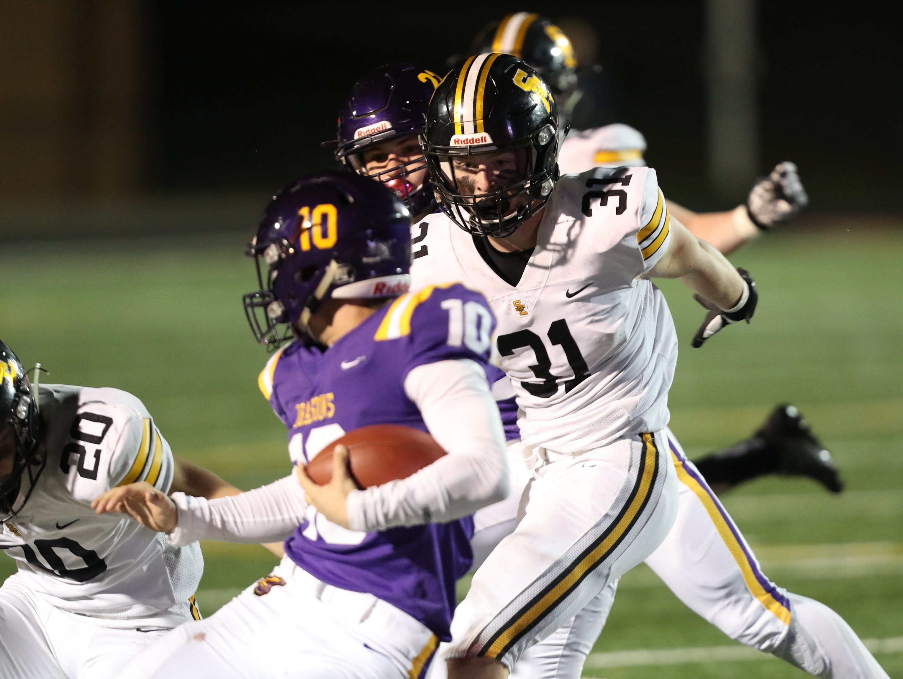 Nov 2, 2018; Johnston, IA, USA; Southeast Polk Rams Carter Olesen (31) tackles Johnston Dragons Andrew Nord (10) at Johnston Stadium. The Rams beat the Dragons 21-7.