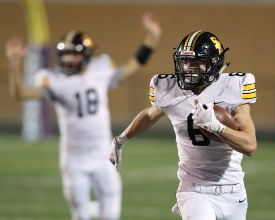 Southeast Polk's Dylan Travis (6) runs up the field against Johnston at Johnston Stadium on Nov. 2, 2108.