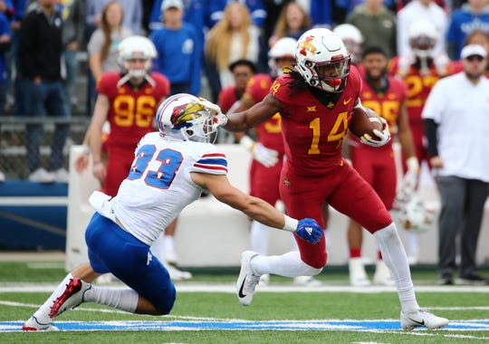 Nov 3, 2018; Lawrence, KS, USA; Iowa State Cyclones wide receiver Tarique Milton (14) stiff arms Kansas Jayhawks linebacker Drew Harvey (33) in the first half at Memorial Stadium.
