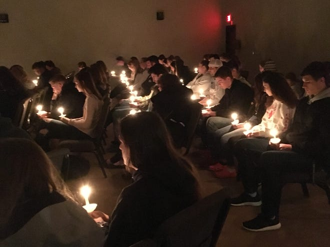Candlelight illuminated Capital City Church on Friday night for a vigil held in honor of Max Druhl, a Saydel High School student who died that Morning.