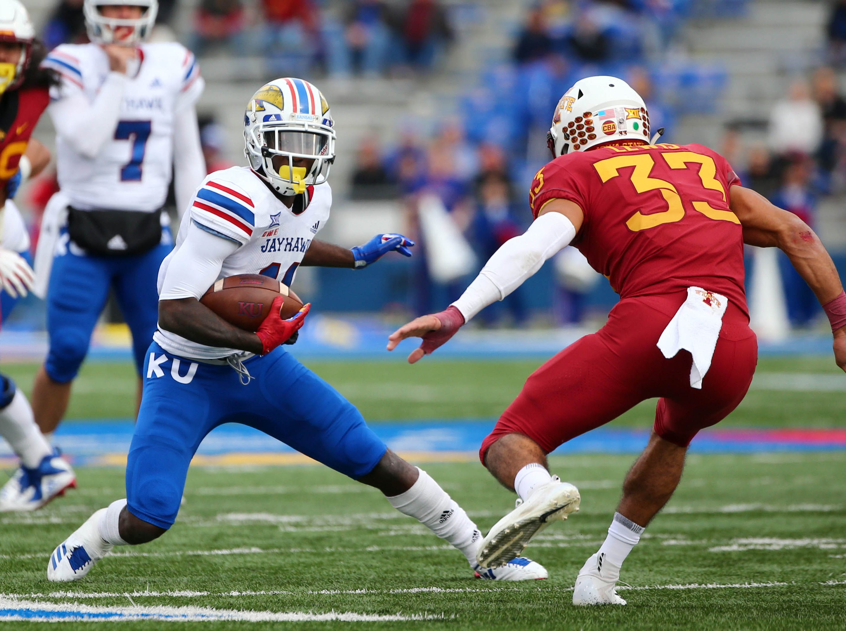 Nov 3, 2018; Lawrence, KS, USA; Kansas Jayhawks wide receiver Steven Sims Jr. (11) runs against Iowa State Cyclones defensive back Braxton Lewis (33) in the first half at Memorial Stadium.