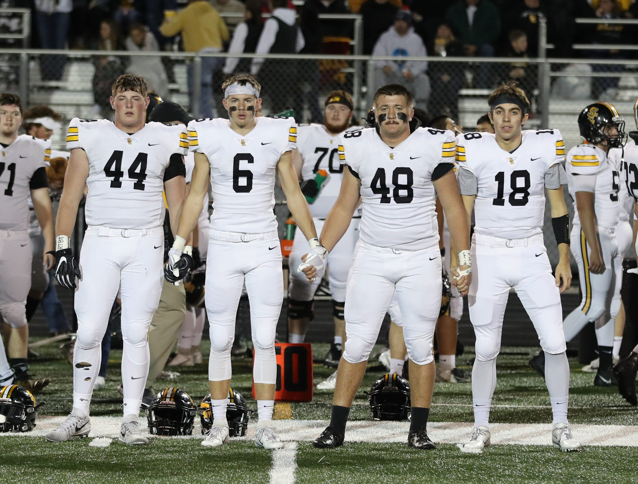 Nov 2, 2018; Johnston, IA, USA; Southeast Polk Rams captains enter the field before their game with the Johnston Dragons at Johnston Stadium. The Rams beat the Dragons 21-7.