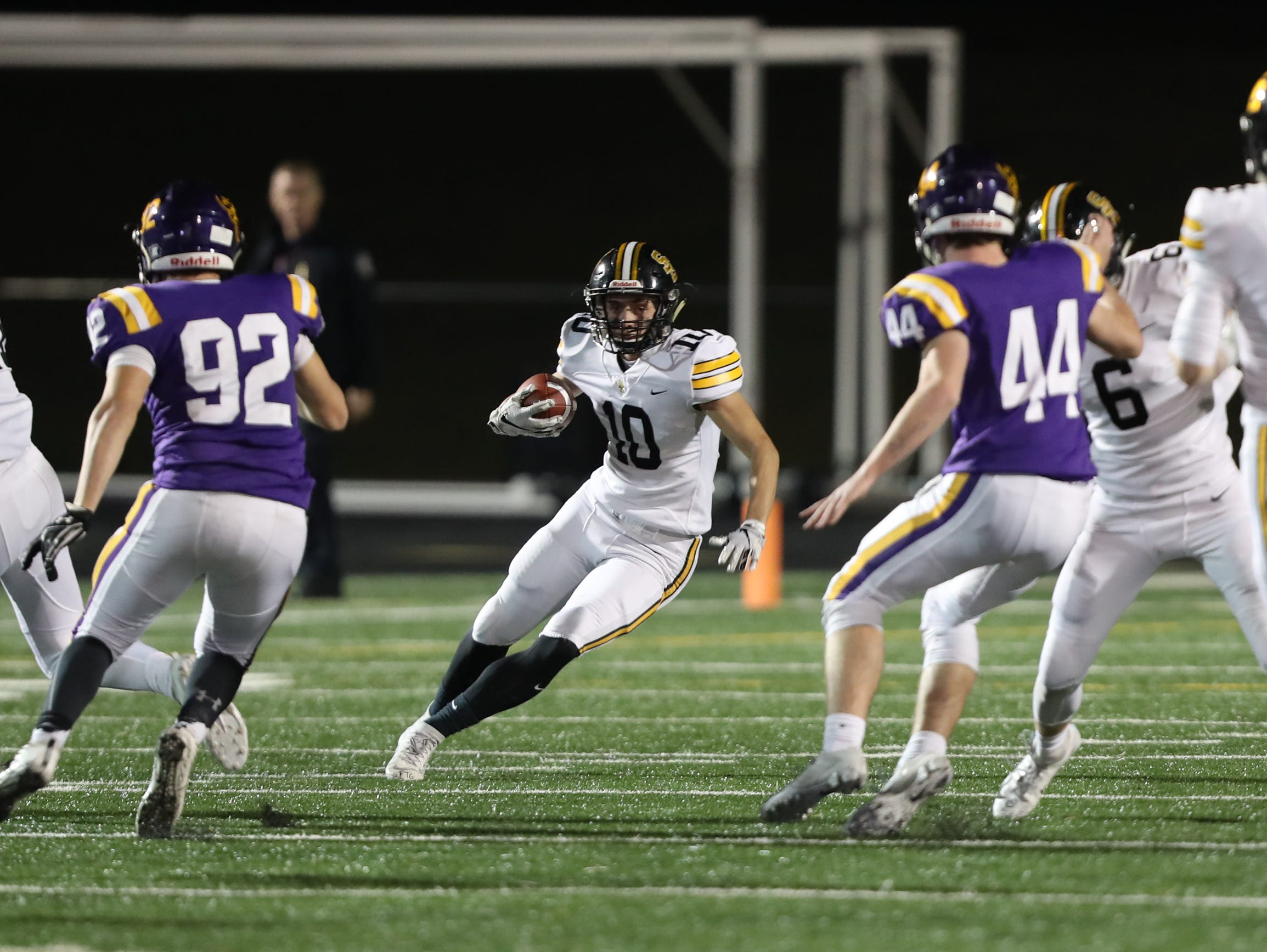Nov 2, 2018; Johnston, IA, USA; Southeast Polk Rams Mason Fairchild (10) finds some running room against the Johnston Dragons at Johnston Stadium. The Rams beat the Dragons 21-7.