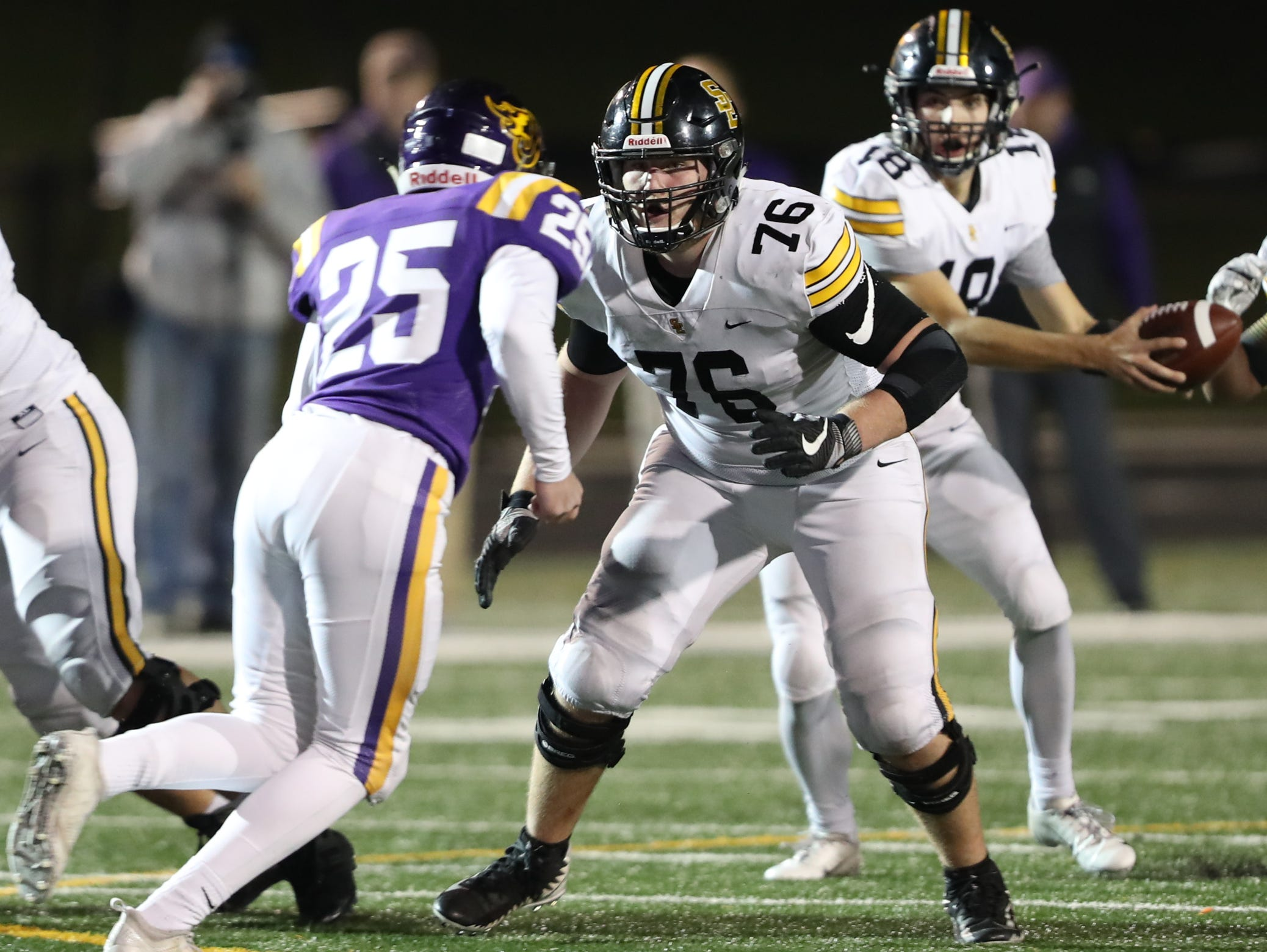 Nov 2, 2018; Johnston, IA, USA; Southeast Polk Rams Josiah Rowland (76) blocks Johnston Dragons Jake Thilges (25) at Johnston Stadium. The Rams beat the Dragons 21-7.