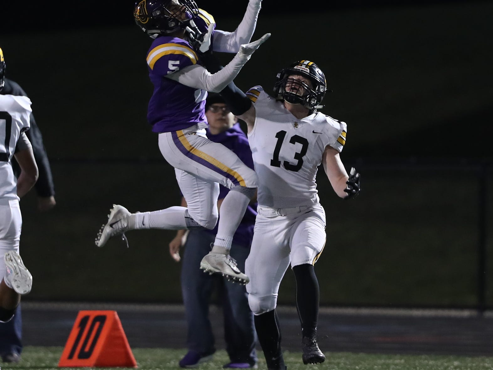 Nov 2, 2018; Johnston, IA, USA; Johnston Dragons Anthony Coleman (5) makes a catch over Southeast Polk Rams Jacob Robillard (13) at Johnston Stadium. The Rams beat the Dragons 21-7.