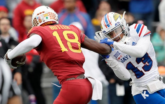 Iowa State wide receiver Hakeem Butler (18) gets away from Kansas cornerback Hasan Defense (13) while scoring a touchdown during the first half of an NCAA college football game in Lawrence, Kan., Saturday, Nov. 3, 2018.