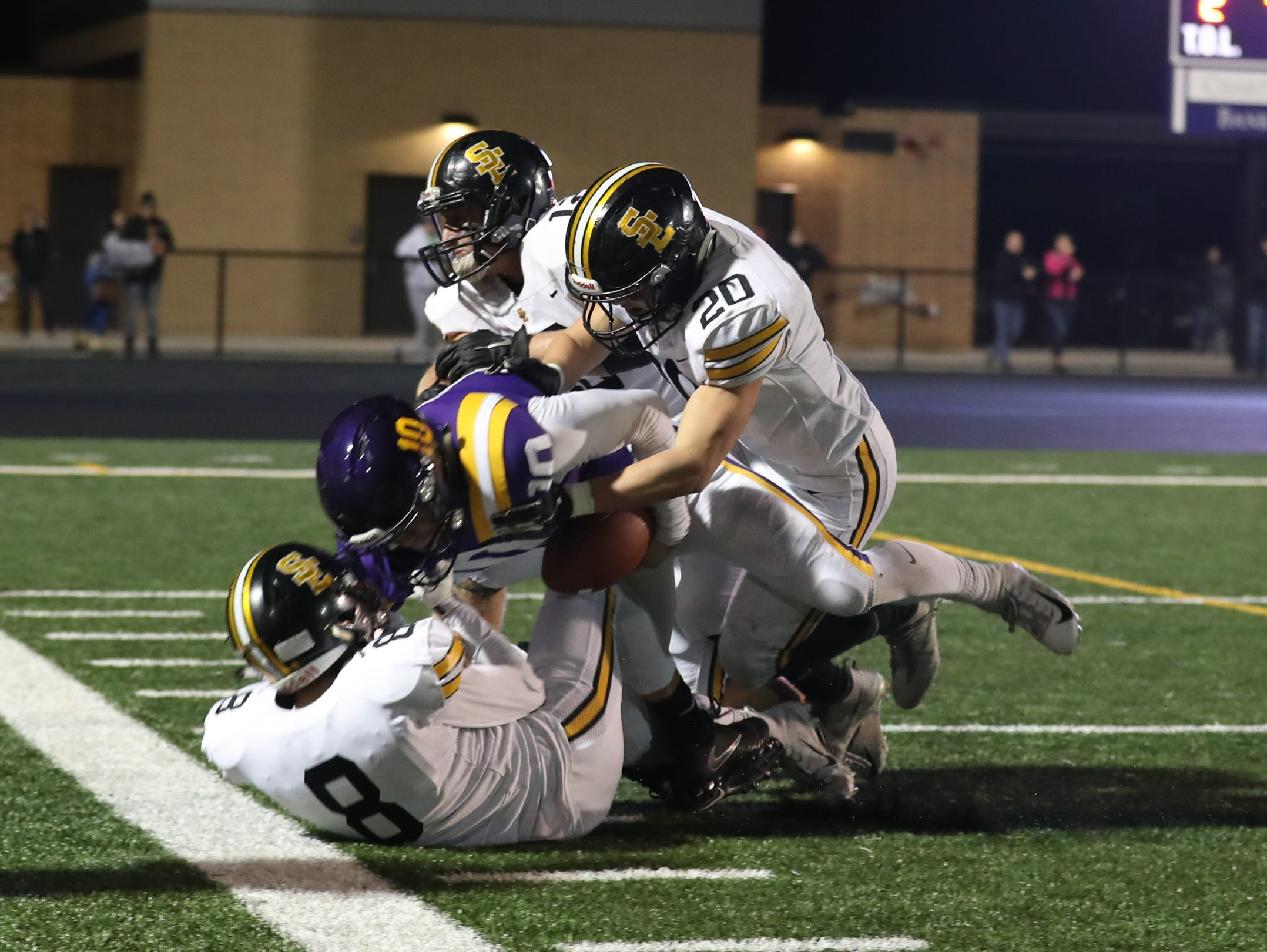 Nov 2, 2018; Johnston, IA, USA; Johnston Dragons Andrew Nord (10) is gang tackled my the Southeast Polk Rams at Johnston Stadium. The Rams beat the Dragons 21-7.