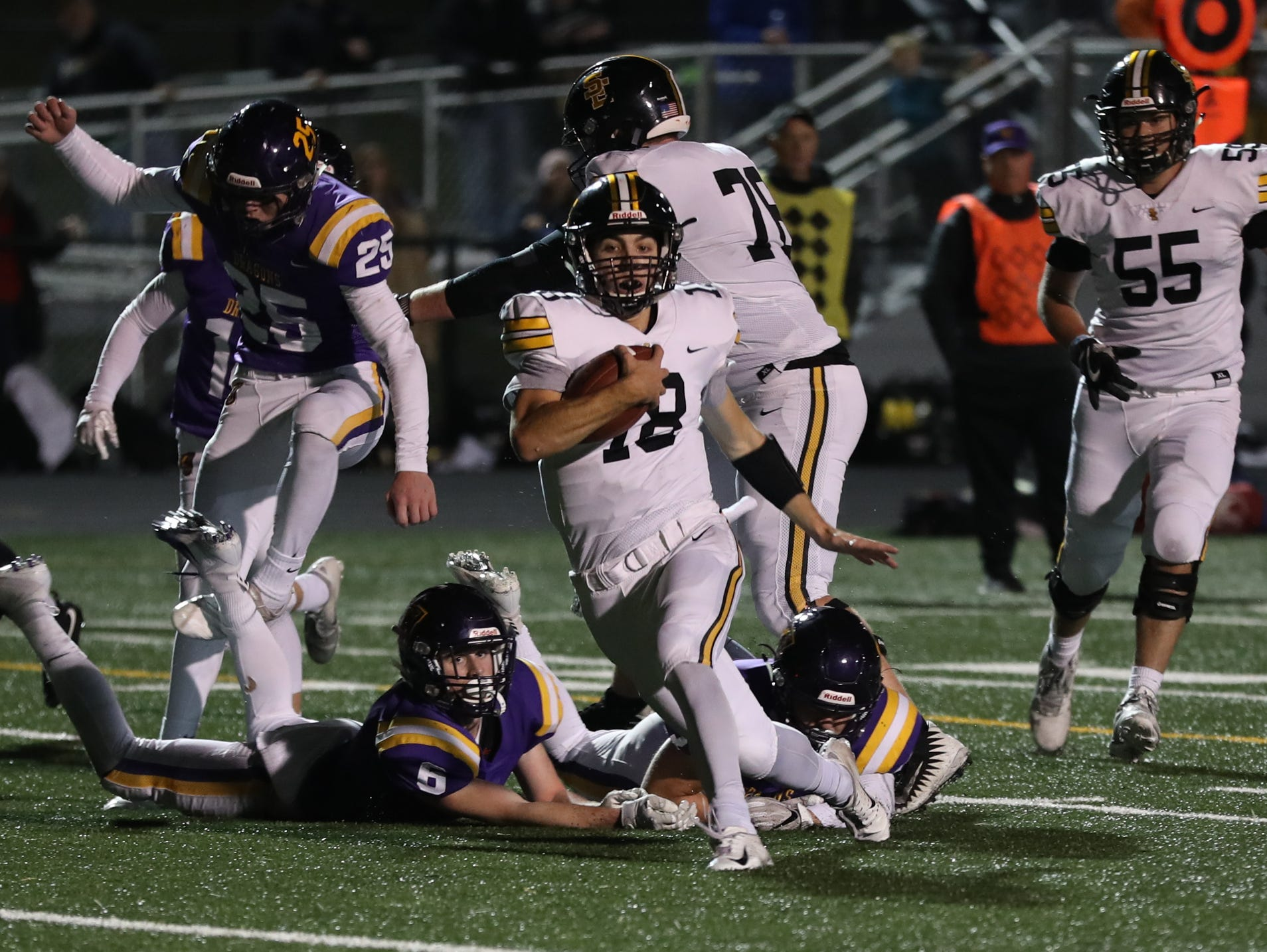 Nov 2, 2018; Johnston, IA, USA; Johnston Dragons Quincy Hale (18) scores a TD against the Southeast Polk Rams at Johnston Stadium. The Rams beat the Dragons 21-7.