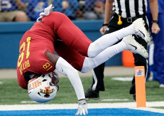 Iowa State wide receiver Hakeem Butler (18) dives in for a touchdown during the first half of an NCAA college football game against Kansas in Lawrence, Kan., Saturday, Nov. 3, 2018.