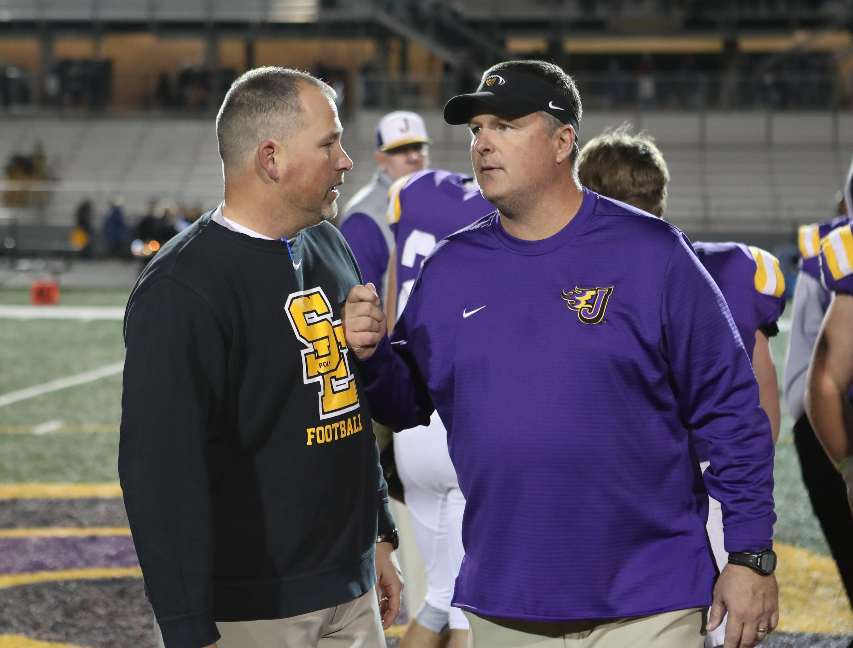 Nov 2, 2018; Johnston, IA, USA; Southeast Polk Rams head coach Brad Zelenovich and Johnston Dragons head coach Brian Woodley visit after the game at Johnston Stadium. The Rams beat the Dragons 21-7.