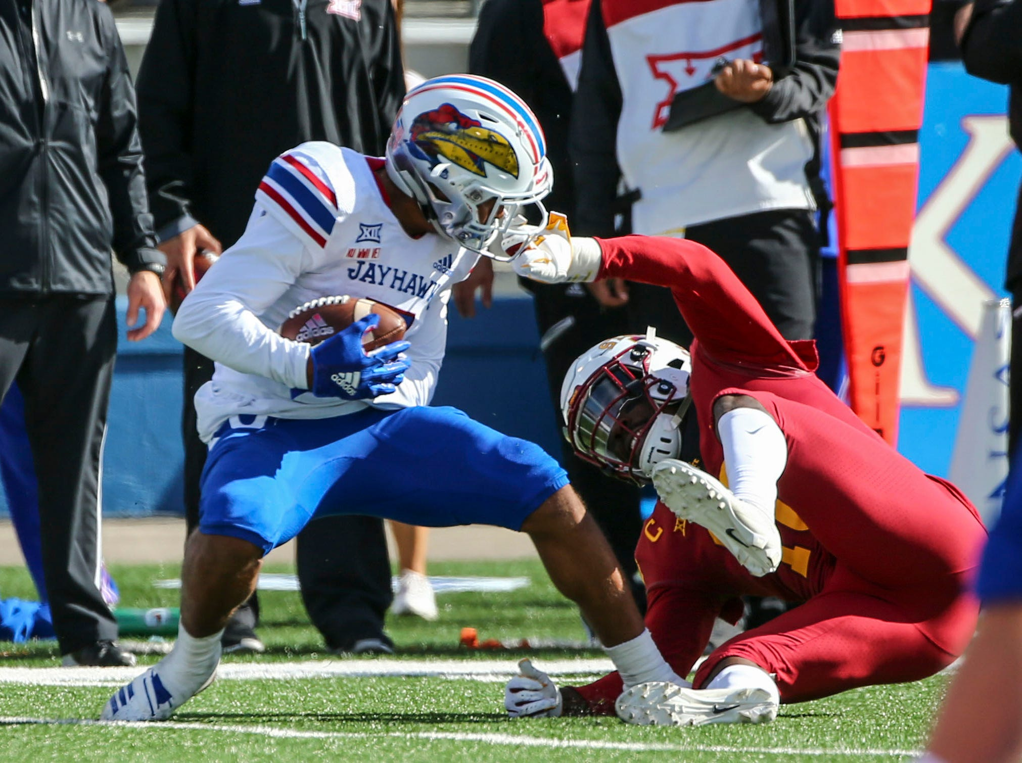 Nov 3, 2018; Lawrence, KS, USA; Kansas Jayhawks wide receiver Stephon Robinson (5) is grabbed by his facemask by Iowa State Cyclones defensive back Brian Peavy (10) in the second half at Memorial Stadium.