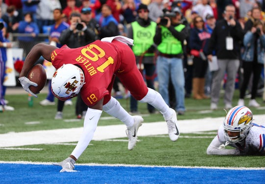 Nov 3, 2018; Lawrence, KS, USA; Iowa State Cyclones wide receiver Hakeem Butler (18) runs for a touchdown against Kansas Jayhawks cornerback Hasan Defense (13) in the first half at Memorial Stadium.