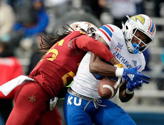 Iowa State defensive back Datrone Young, left, breaks up a pass intended for Kansas wide receiver Jeremiah Booker during the first half of an NCAA college football game in Lawrence, Kan., Saturday, Nov. 3, 2018.