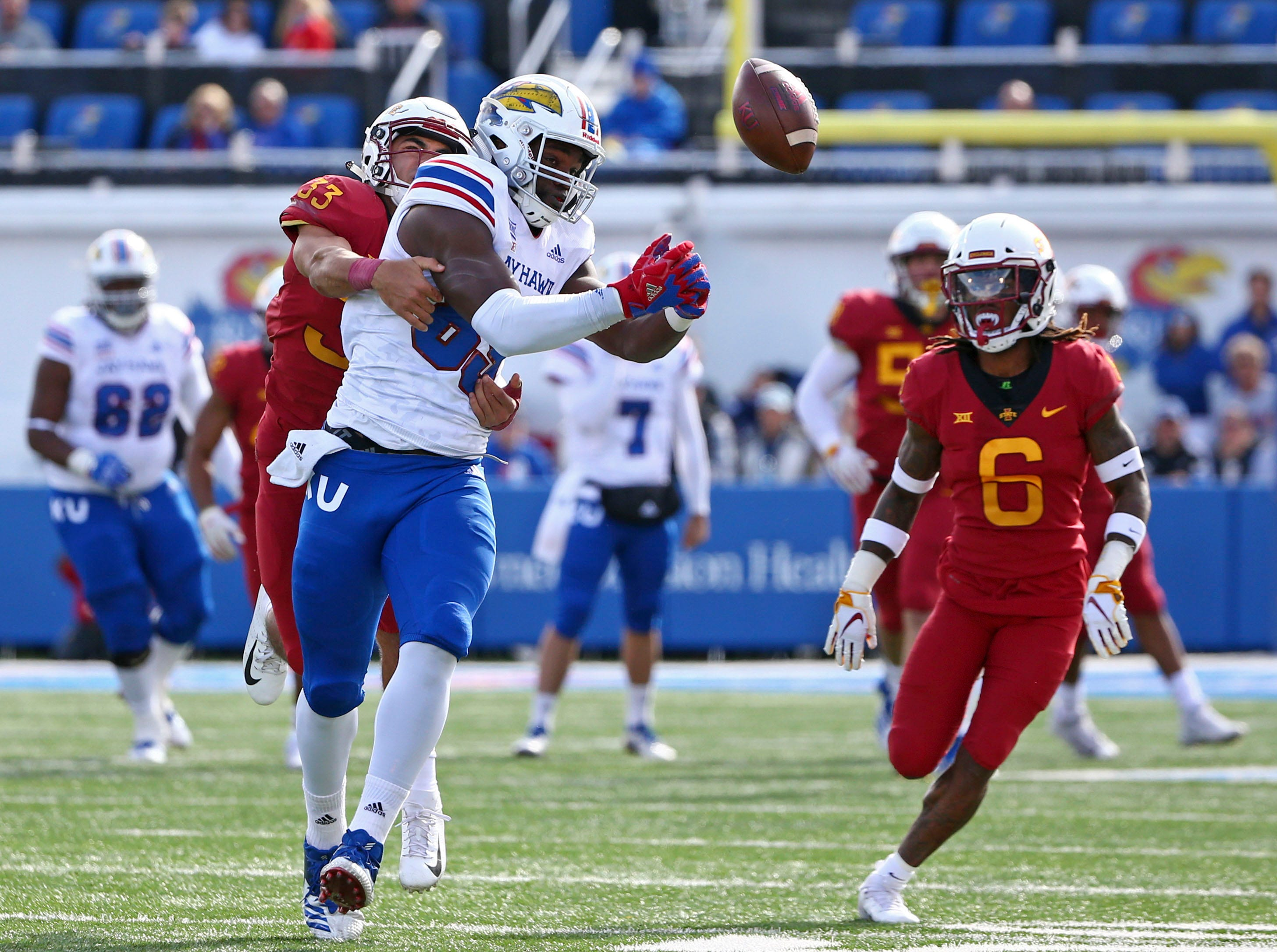 Nov 3, 2018; Lawrence, KS, USA; Kansas Jayhawks tight end Mavin Saunders (89) is unable to make the catch as Iowa State Cyclones defensive backs Braxton Lewis (33) and De'Monte Ruth (6) defend in the second half at Memorial Stadium.