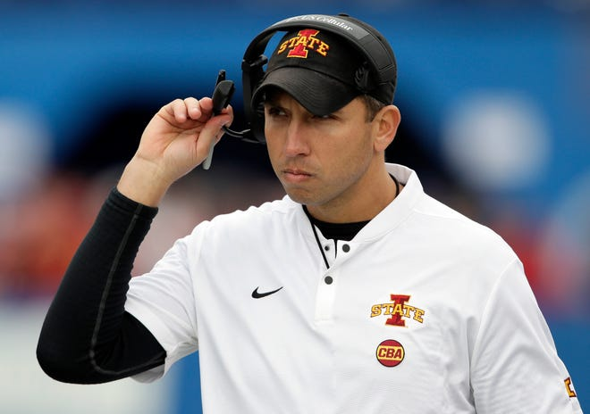 Iowa State head coach Matt Campbell adjusts his headset during the first half of an NCAA college football game against Kansas in Lawrence, Kan., Saturday, Nov. 3, 2018.