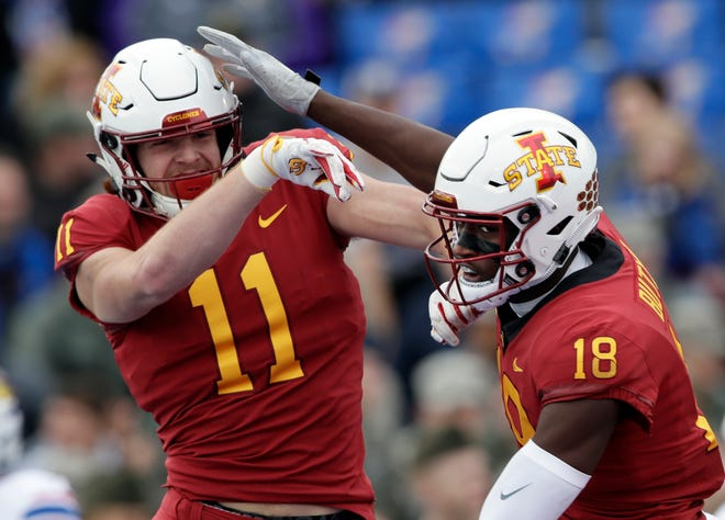 Iowa State tight end Chase Allen (11) congratulates wide receiver Hakeem Butler (18) on his touchdown during the first half of an NCAA college football game against Kansas in Lawrence, Kan., Saturday, Nov. 3, 2018.