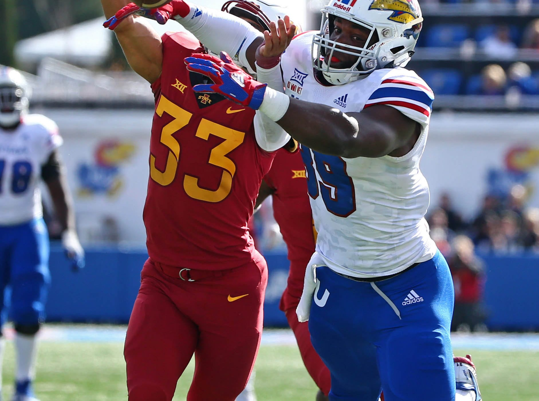 Nov 3, 2018; Lawrence, KS, USA; Kansas Jayhawks tight end Mavin Saunders (89) is unable to make the catch as Iowa State Cyclones defensive back Braxton Lewis (33) defends in the second half at Memorial Stadium.