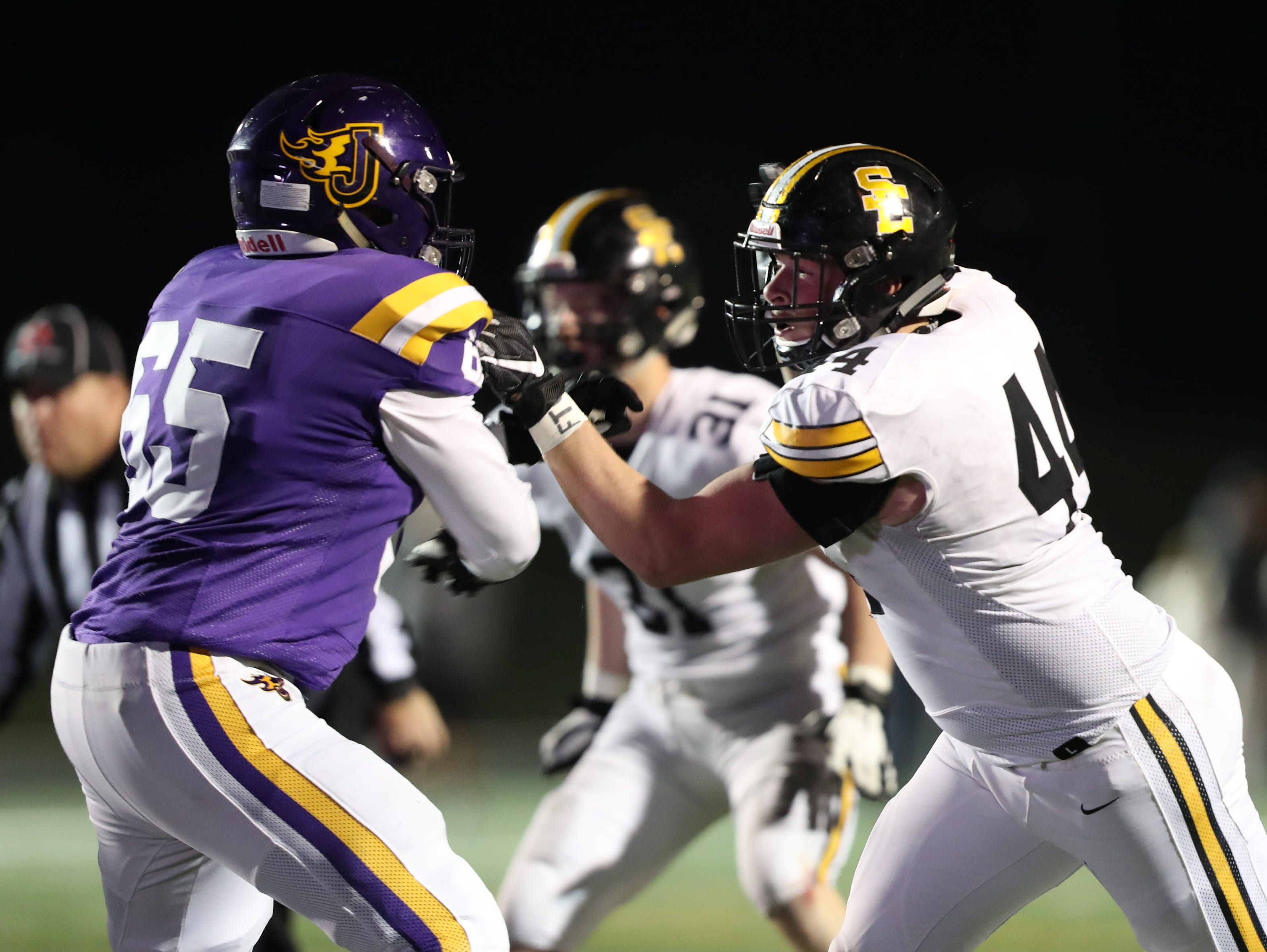 Nov 2, 2018; Johnston, IA, USA; Southeast Polk Rams Tanner VanElsen (44) battles Johnston Dragons Tyler Slagle (65) at Johnston Stadium. The Rams beat the Dragons 21-7.