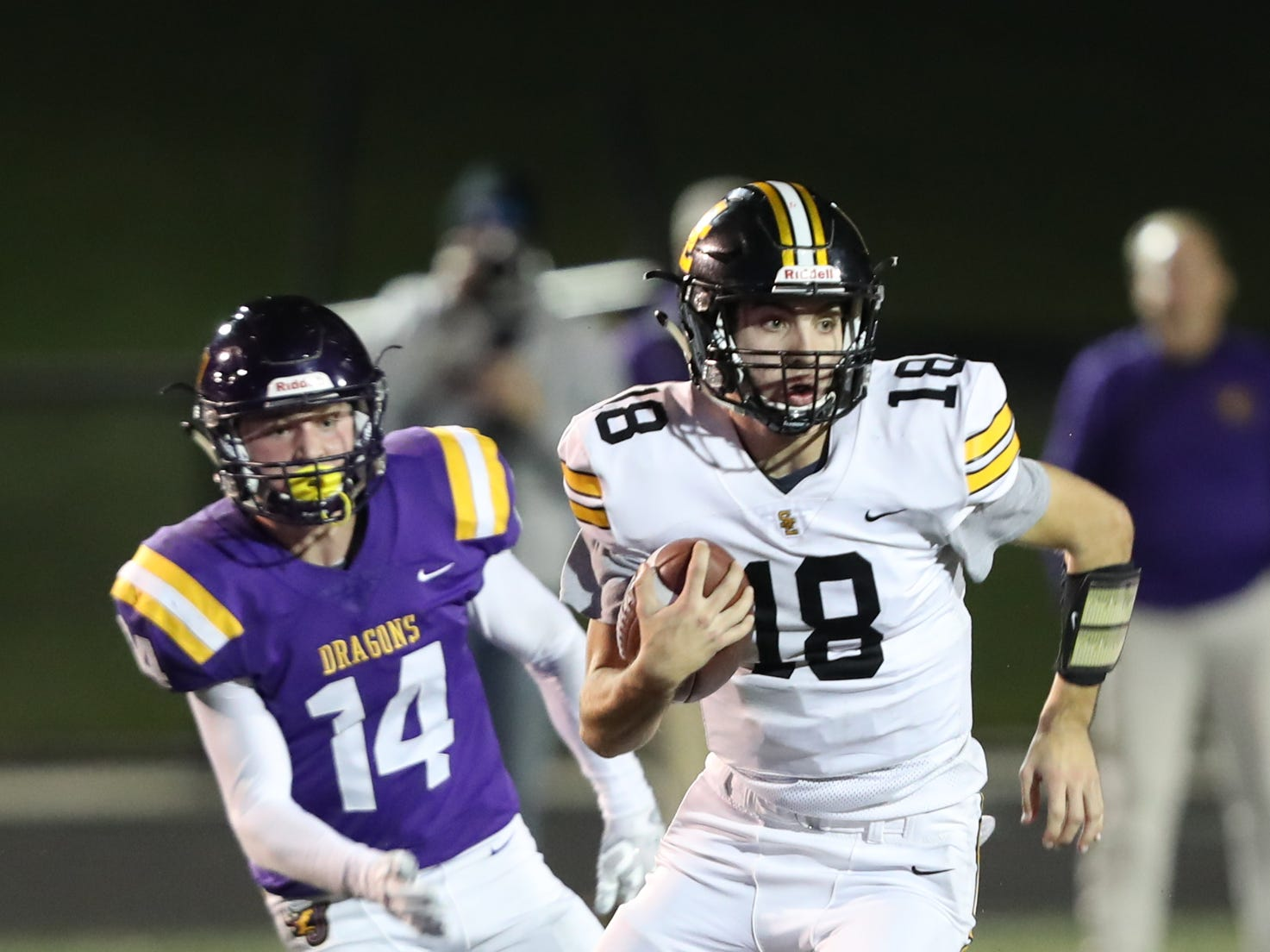 Nov 2, 2018; Johnston, IA, USA; Southeast Polk Rams Josiah Cole (18) runs for a first down against the Johnston Dragons at Johnston Stadium. The Rams beat the Dragons 21-7.