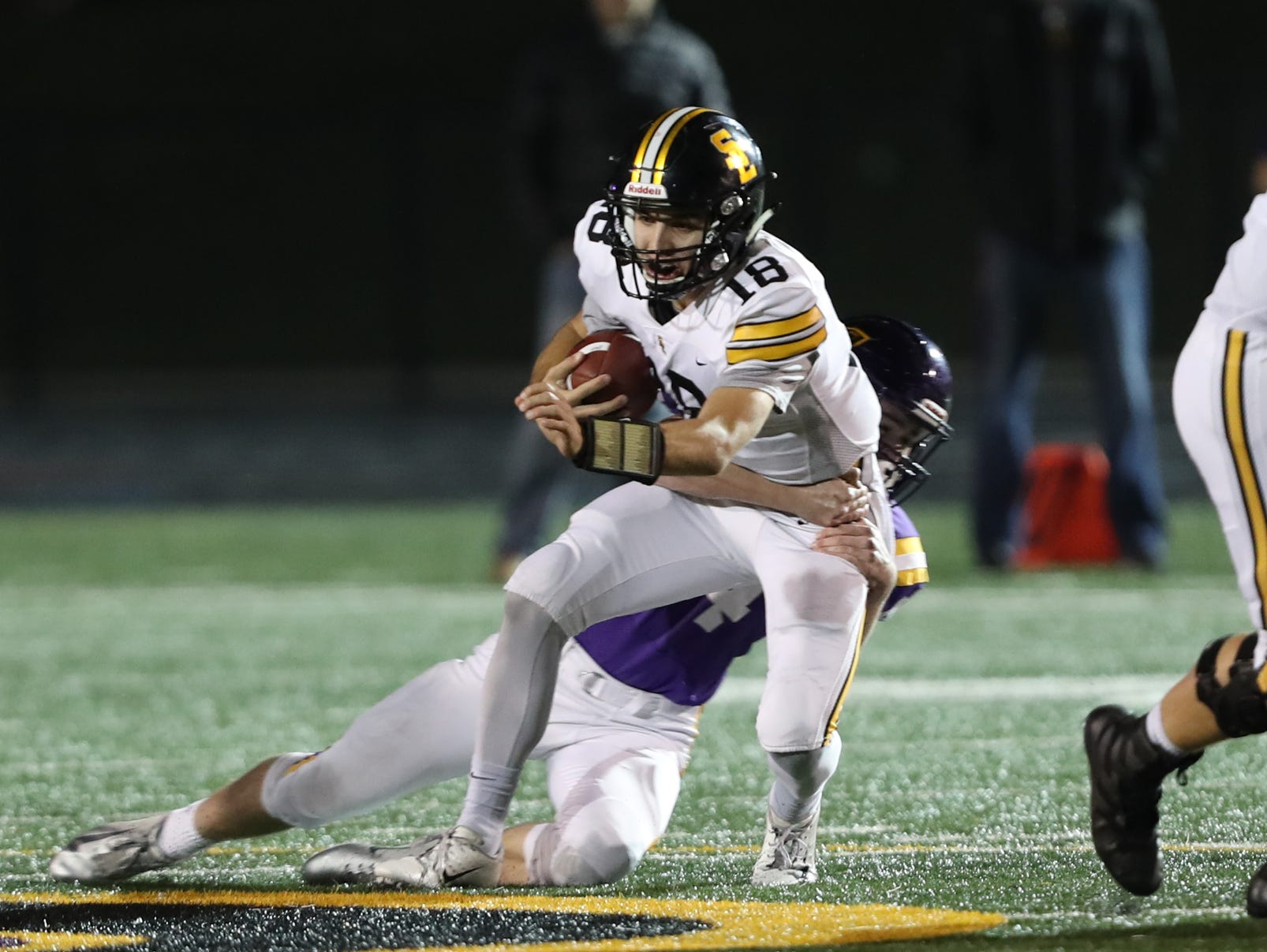Nov 2, 2018; Johnston, IA, USA; Southeast Polk Rams Josiah Cole (18) is tackled by the Johnston Dragons at Johnston Stadium. The Rams beat the Dragons 21-7.