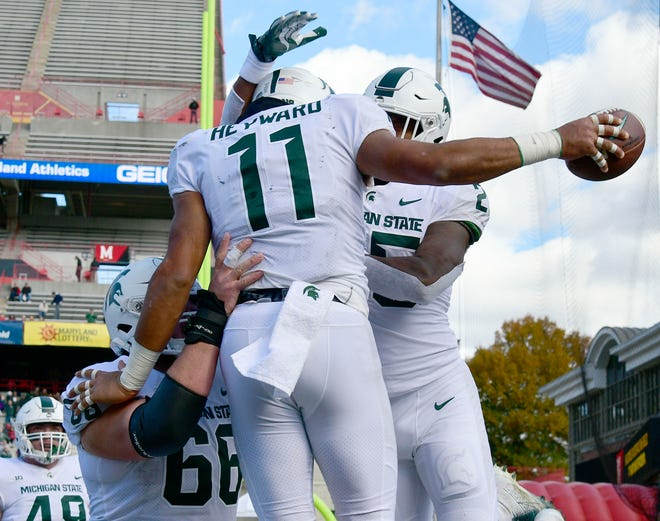Michigan State running back Connor Heyward celebrates with teammates after scoring a touchdown during the first quarter on Saturday, Nov. 3, 2018, at Capital One Field at Maryland Stadium.