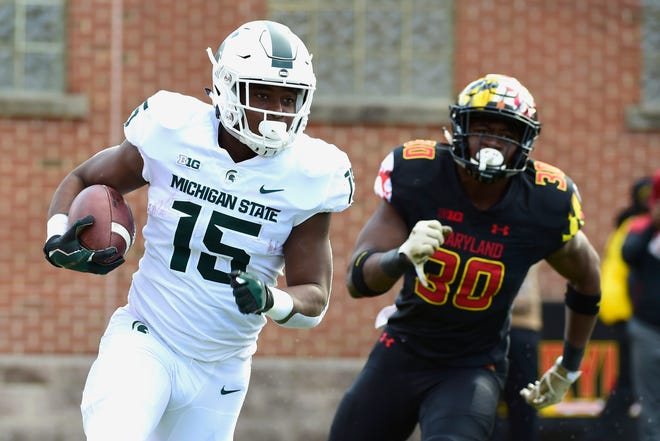 Michigan State running back La'Darius Jefferson rushes as Maryland linebacker Durell Nchami chases during the second quarter at Capital One Field on Saturday, Nov. 3, 2018 in College Park, Maryland.