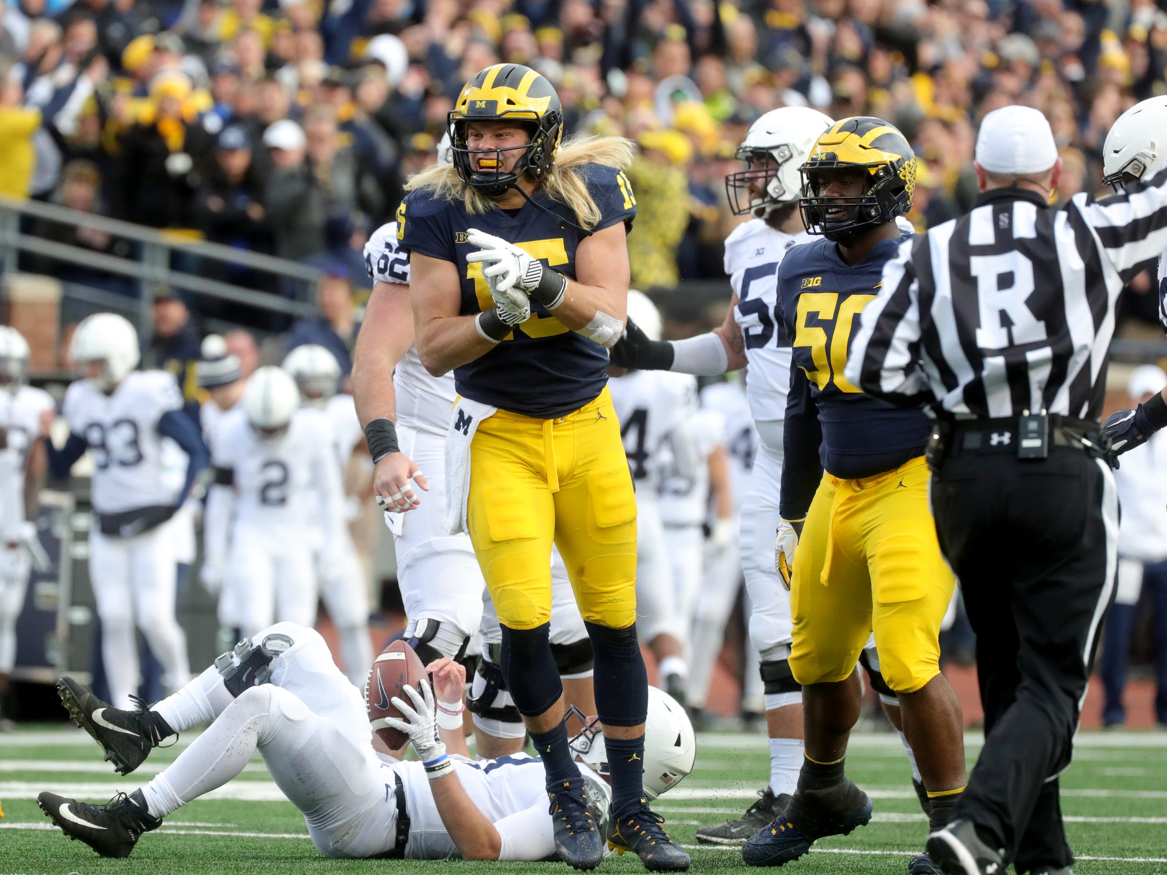 Michigan's Chase Winovich celebrates his sack of Penn State quarterback Trace McSorley during the first half Saturday, November 3, 2018 at Michigan Stadium in Ann Arbor.