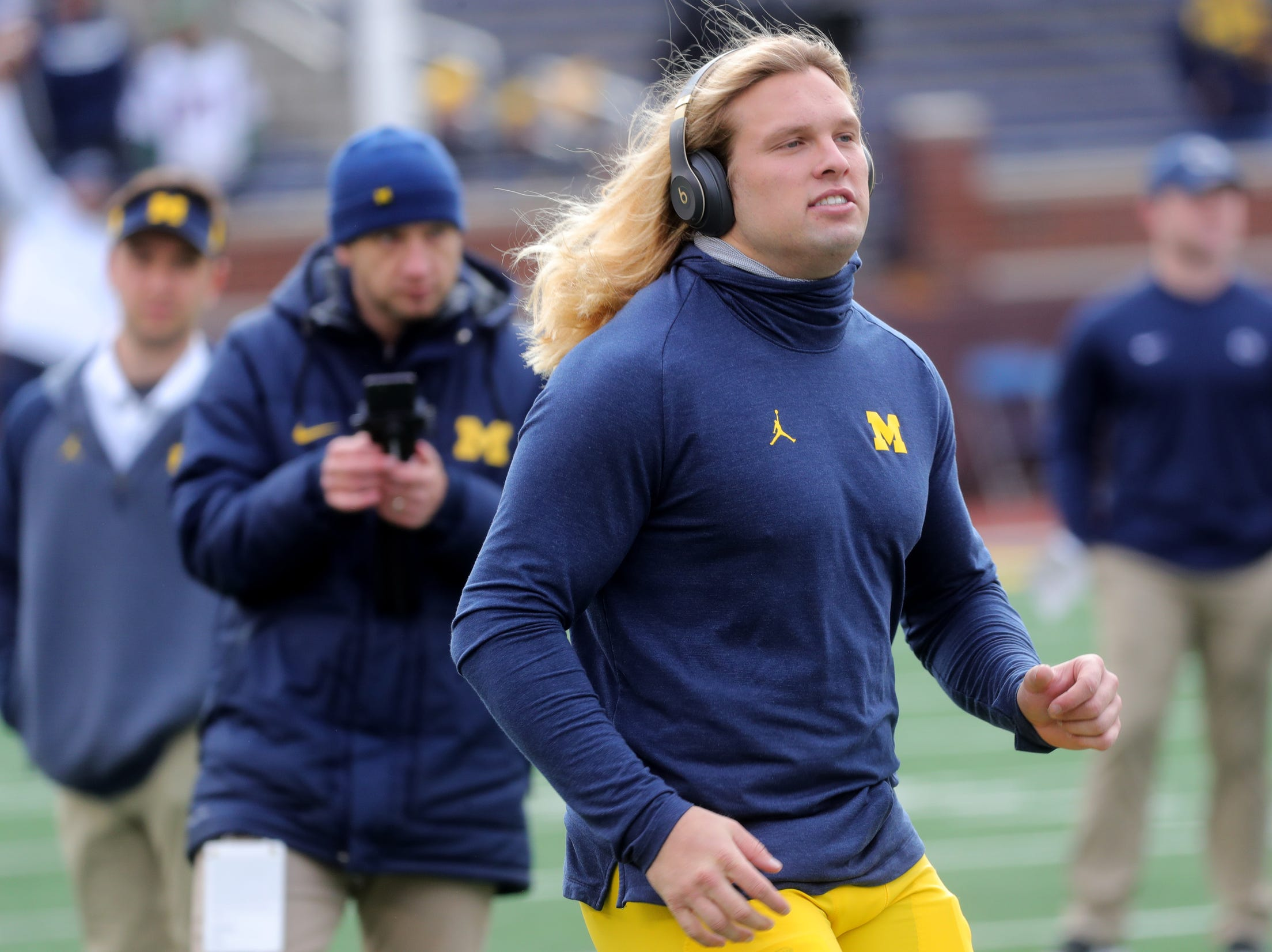 Michigan linebacker Chase Winovich warms up on the field prior to the start of the Michigan and Penn State game on Saturday, Nov. 3, 2018 at Michigan Stadium.
