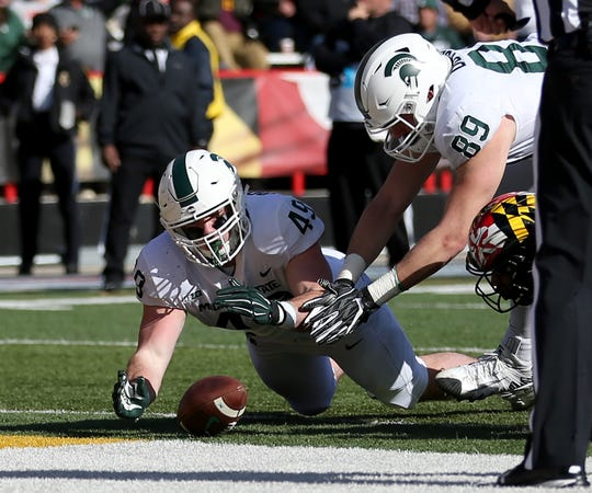 Michigan State fullback Max Rosenthal, left, and tight end Matt Dotson recover a fumble for a touchdown during the second half of MSU's 24-3 win over Maryland on Saturday, Nov. 3, 2018, in College Park, Md.