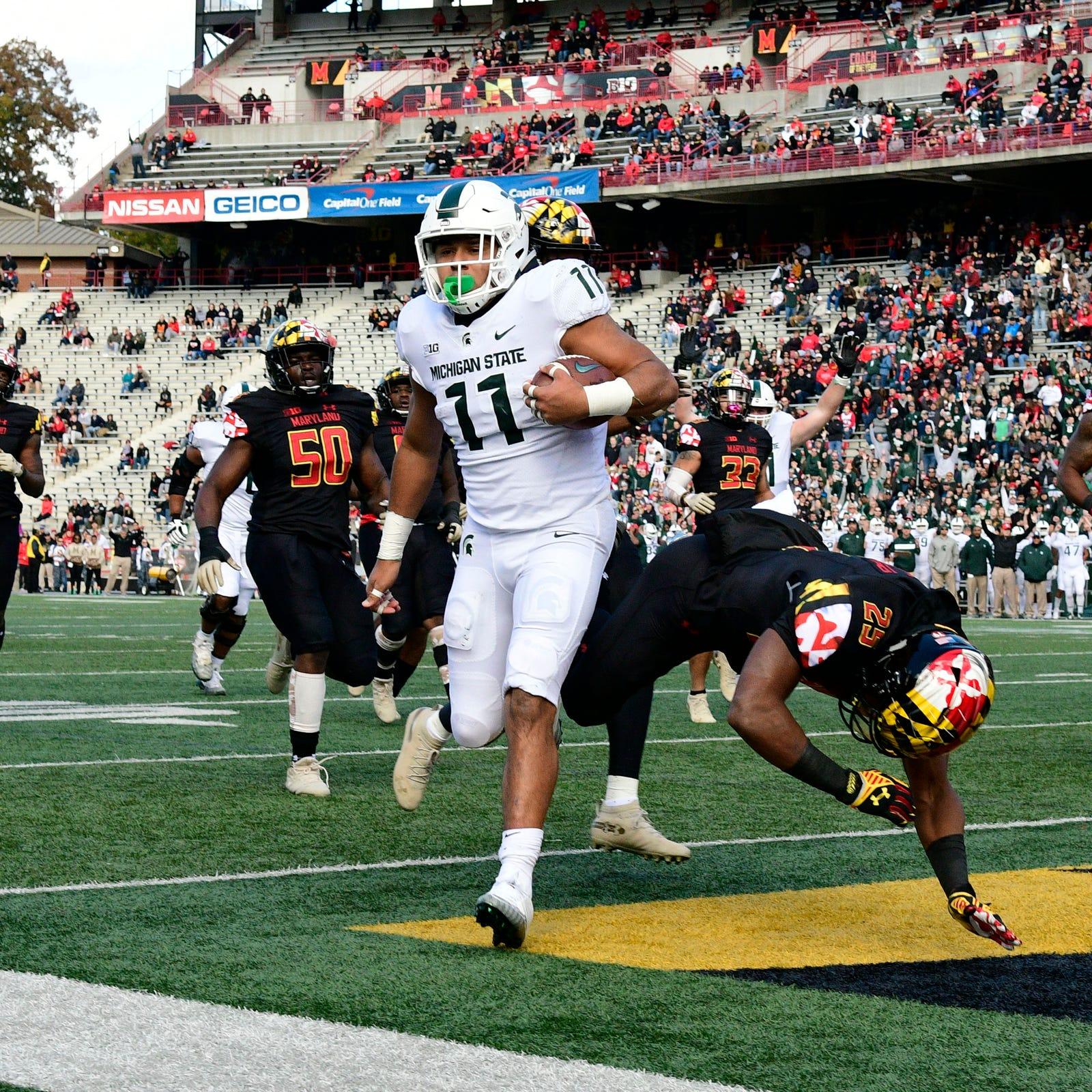 Michigan State running back Connor Heyward runs...