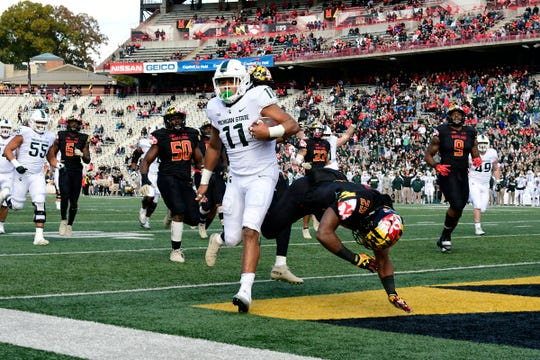 Michigan State running back Connor Heyward runs past Maryland defensive back Antoine Brooks Jr. (25) for a touchdown during the first quarter on Saturday, Nov. 3, 2018, at Capital One Field at Maryland Stadium.