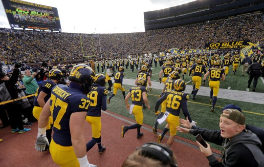 The Michigan football team takes the field prior to the start of their game against Penn State on Saturday, Nov. 3, 2018 at Michigan Stadium.