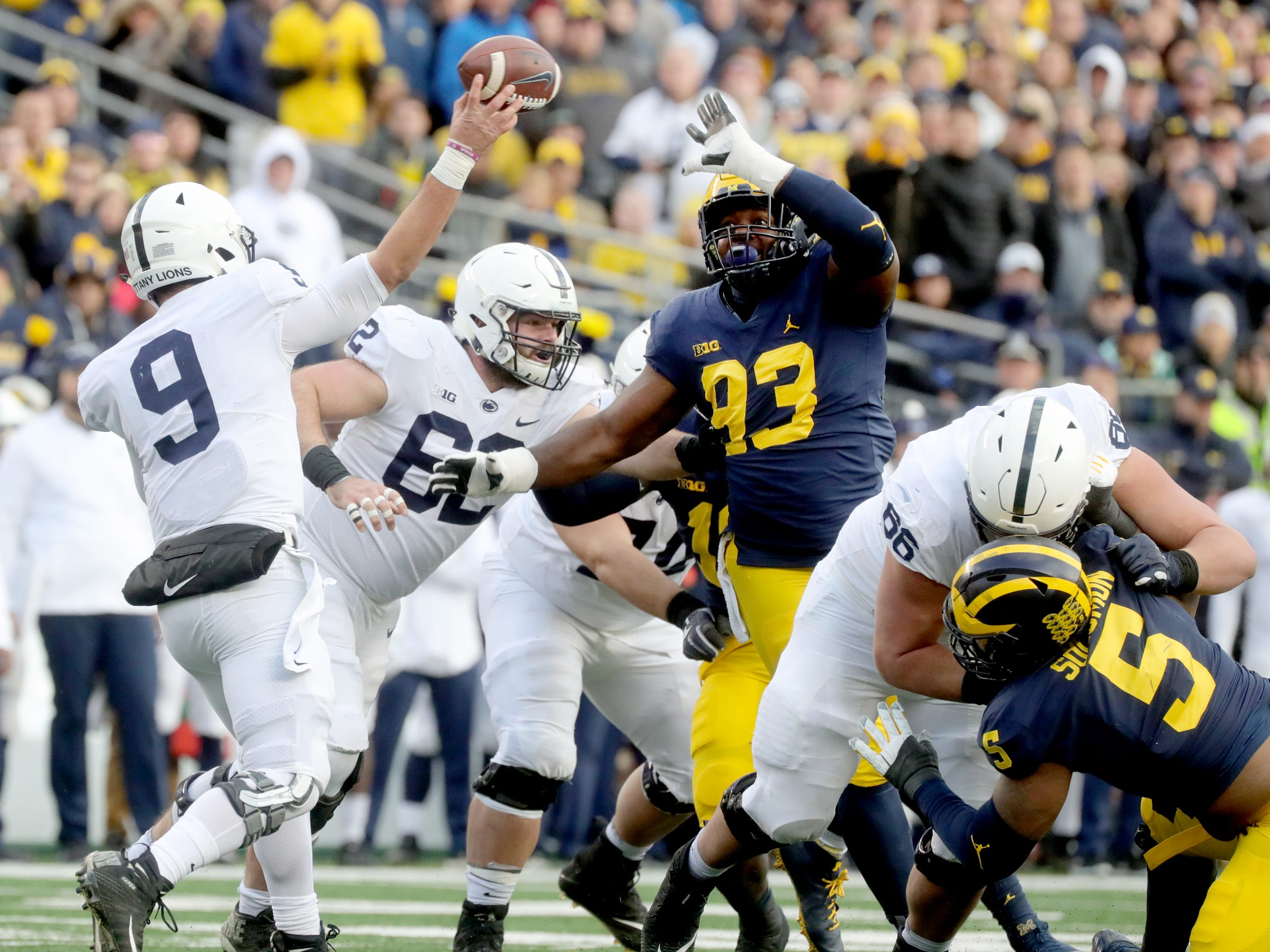 Michigan's Lawrence Marshall rushes Penn State quarterback Trace McSorley during the first half Saturday, November 3, 2018 at Michigan Stadium in Ann Arbor.