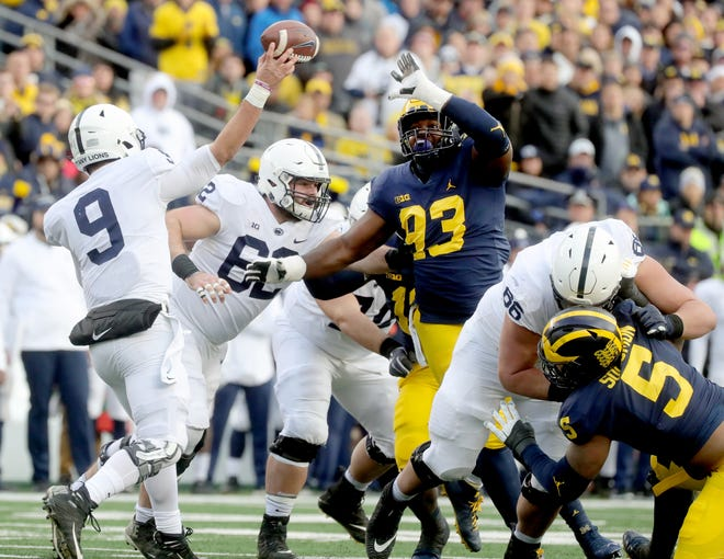 Michigan's Lawrence Marshall rushes Penn State quarterback Trace McSorley during the first half Saturday.