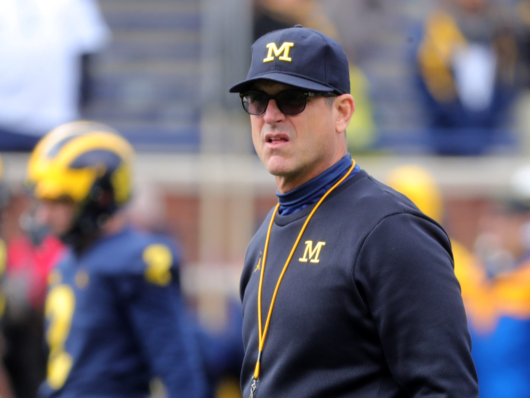 Michigan coach Jim Harbaugh watches his team warm up prior to the game against Penn State on Saturday, Nov. 3,2018, at Michigan Stadium.