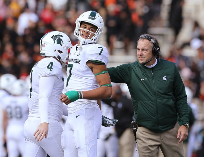 Michigan State coach Mark Dantonio, right, congratulates players Matt Coghlin and Cody White (7) after a successful field goal against Maryland in the first half on Saturday, Nov. 3, 2018, in College Park, Md.