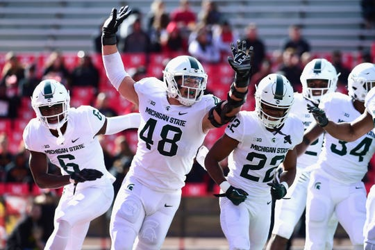 Michigan State defensive end Kenny Willekes (48) celebrates with teammates during the first quarter on Saturday, Nov. 3, 2018, at Capital One Field at Maryland Stadium.