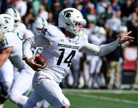 Michigan State quarterback Brian Lewerke runs for a first down during the first quarter on Saturday, Nov. 3, 2018, at Capital One Field at Maryland Stadium.