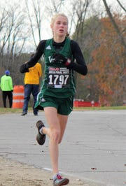 Muskegon West Michigan Christian freshman Abby VenderKooi dominated in the MHSAA Division 4 girls cross-country finals, winning her race by 1 minute, 15 seconds.
