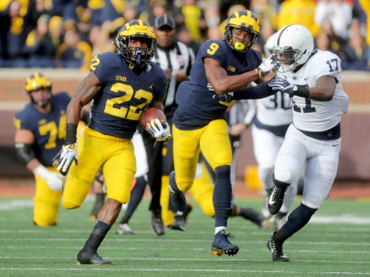 Karan Higdon runs for yardage against Penn State.