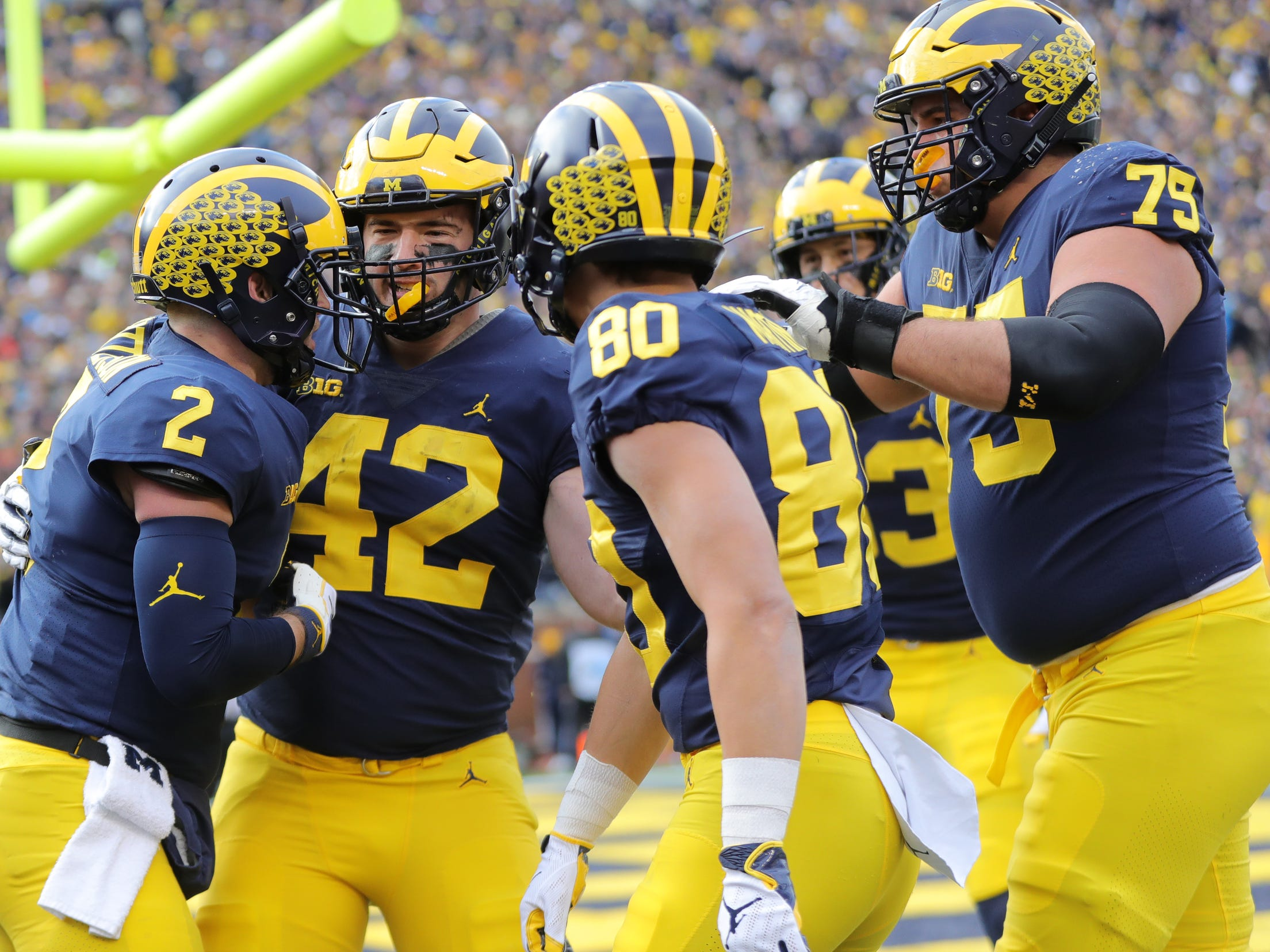 Michigan quarterback Shea Patterson (2) celebrates his TD with Ben Mason, Oliver Martin and Greg Robinson against Penn State during the first half Saturday, November 3, 2018 at Michigan Stadium in Ann Arbor.