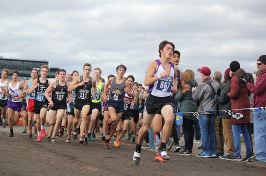 About 800 meters into the race, the lead pack of runners in the Division 1 boys race rounds the first turn.