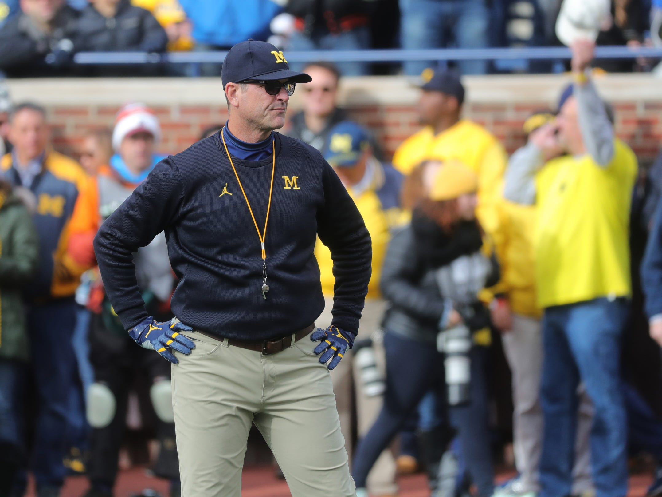 Michigan coach Jim Harbaugh watches his team warm up prior to the game against Penn State on Saturday, Nov. 3, 2018, at Michigan Stadium.